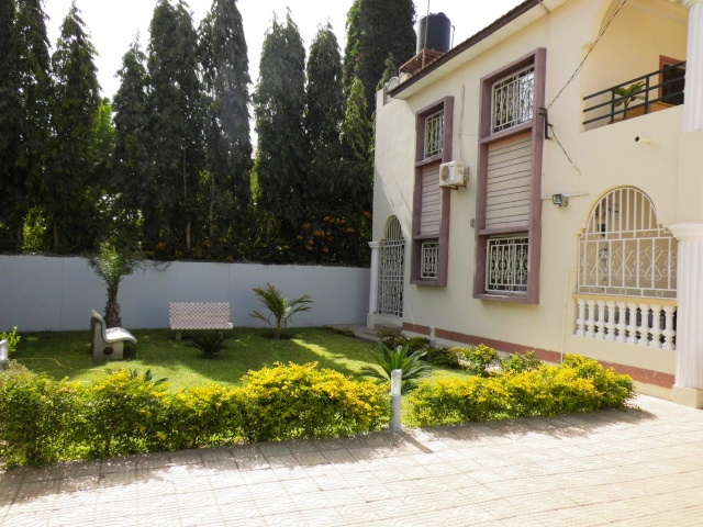 4 bedroom fully furnished house with nice garden and a boys quarters
