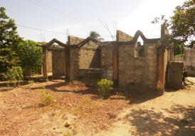 Incomplete 2-bed room house on a 20m by 20m plot